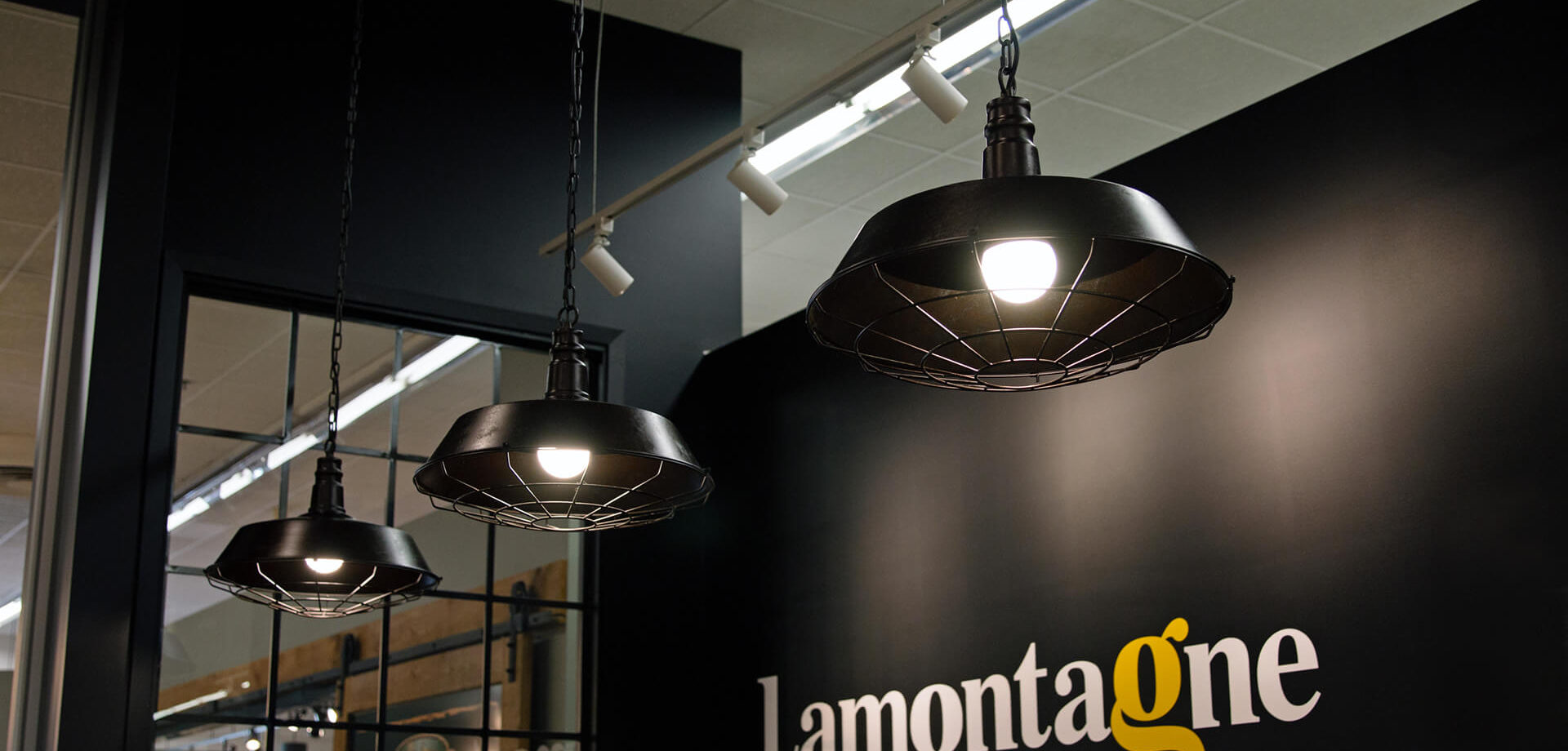 Lamontagne bakery logo on a black wall